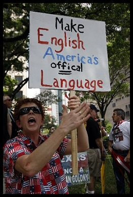http://www.bradblog.com/Images/Protestor_EnglishOfficalLanguage.jpg
